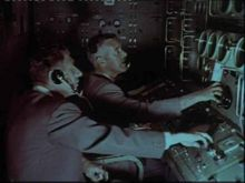 Don Blackman (foreground) and Ken Lee (background) locking on. Don later transferred to the Carnarvon Tracking Station:Still photo taken from a NASA film