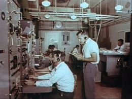 Operational action Left foreground - Jack Duperouzel on AcqAidRight background - Gus Pugh on M&O console:Photo - ???